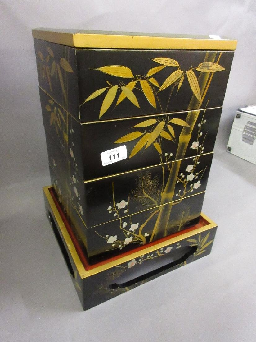 Japanese square lacquered four section box on stand