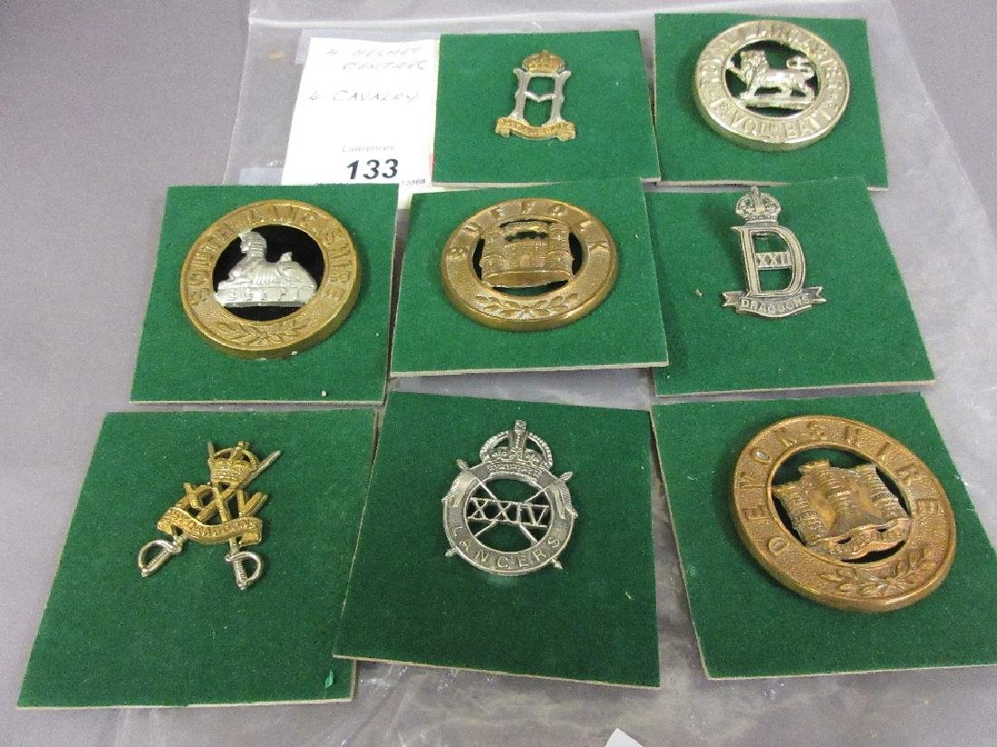 Group of four helmet plate badges and four Cavalry