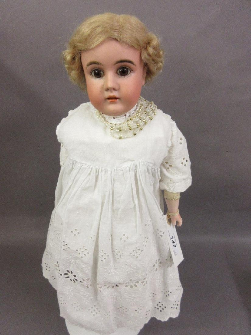 Bisque headed shoulder plate doll having leather body,