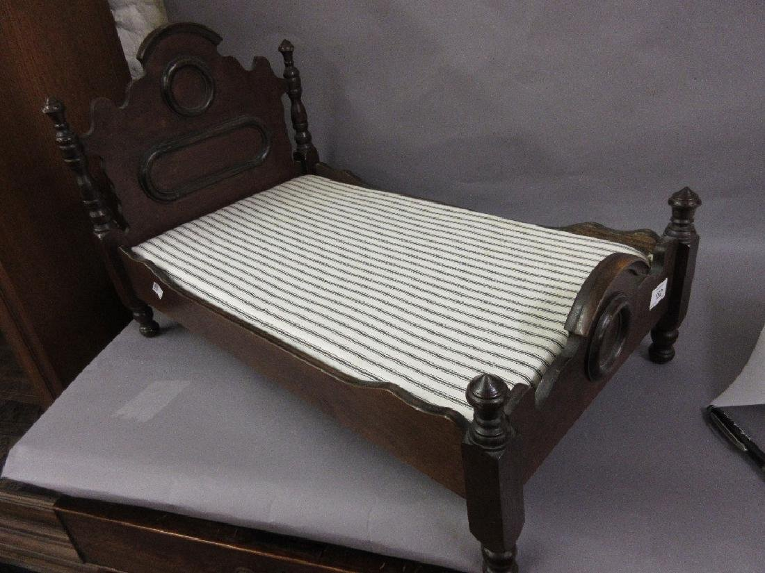 Mahogany Victorian style doll's bed with mattress,