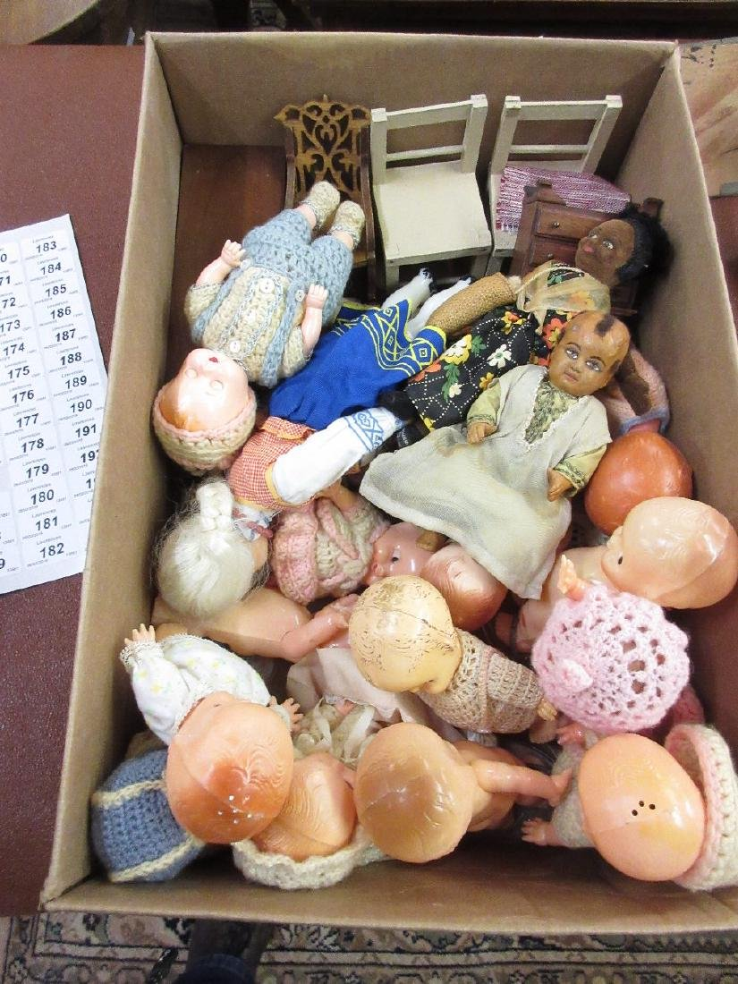 Box containing a quantity of various dolls including