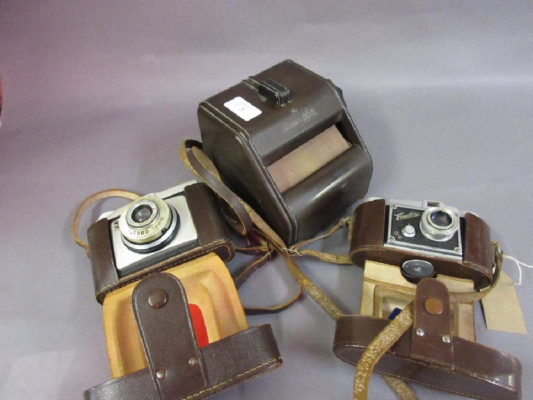 Two 35mm cameras and a Bakelite cased photographic