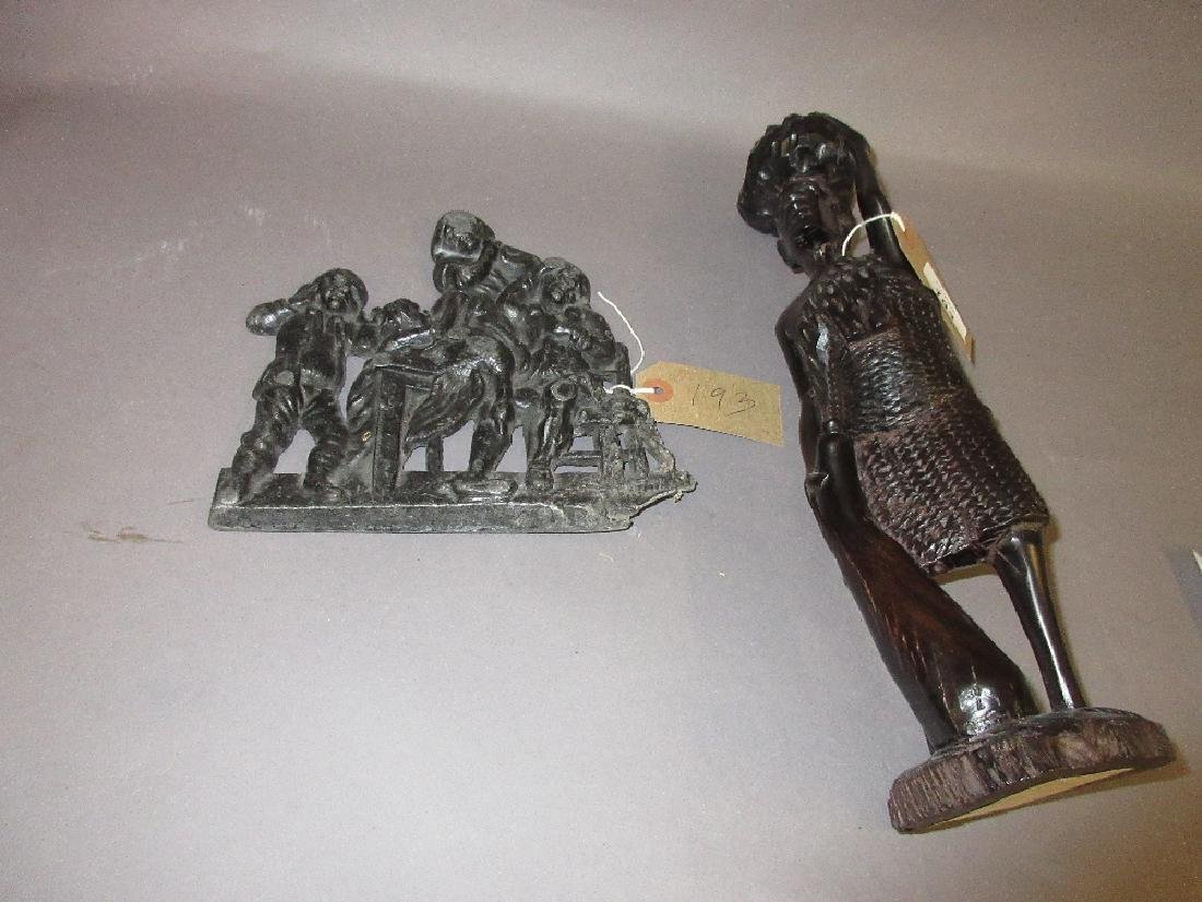 African carved hardwood figure of a man together with
