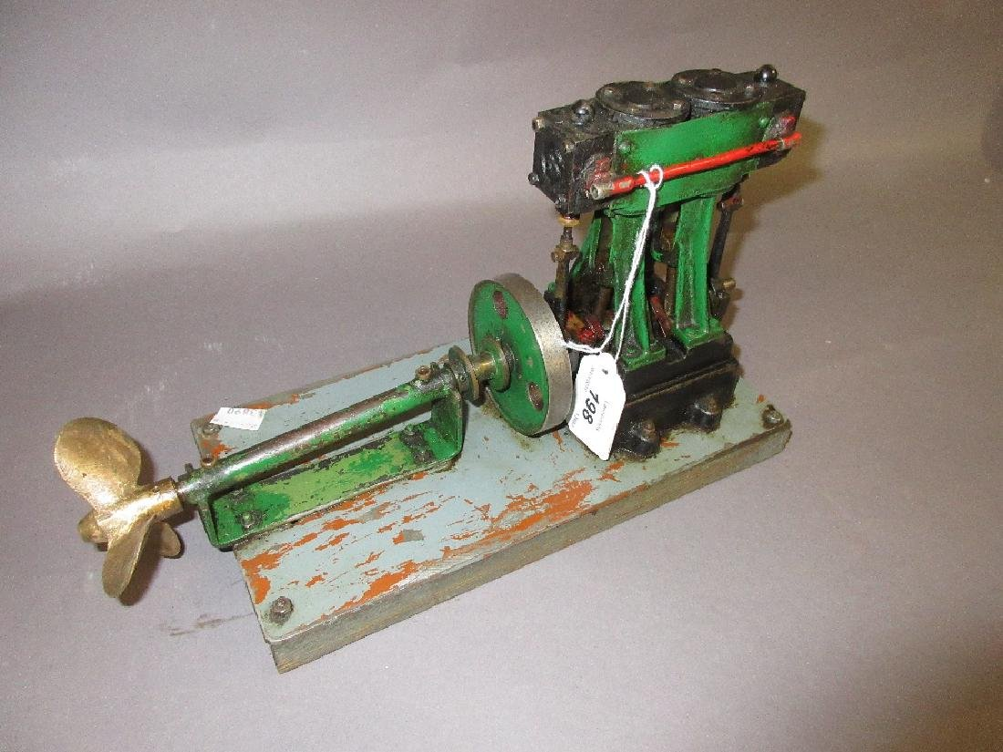Twin piston vertical stationary engine with attached