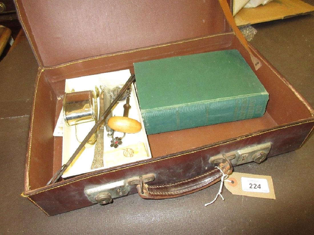 Small leather case containing miscellaneous items