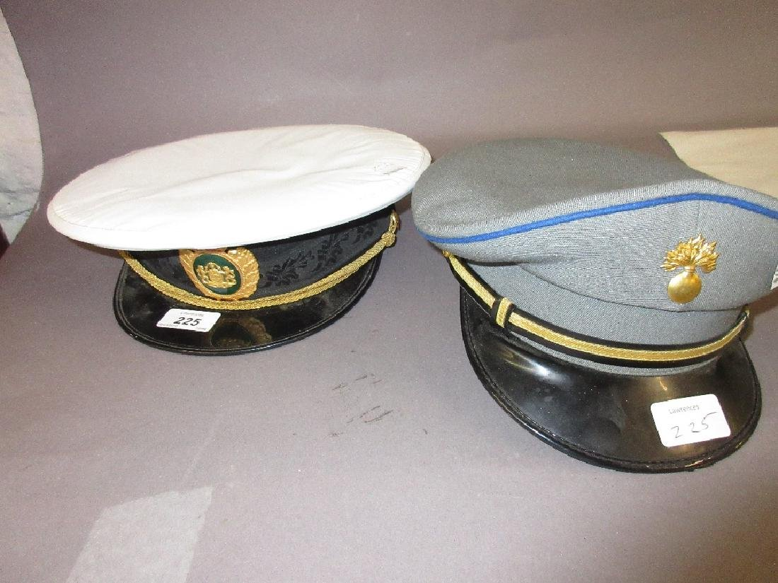 Two military peaked hats