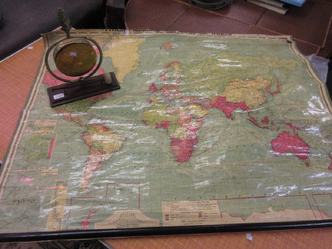 20th Century rolled map of the World (at fault) and a
