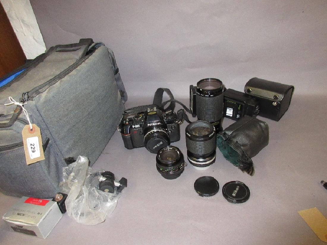 Nikon F301 camera outfit with various makes of