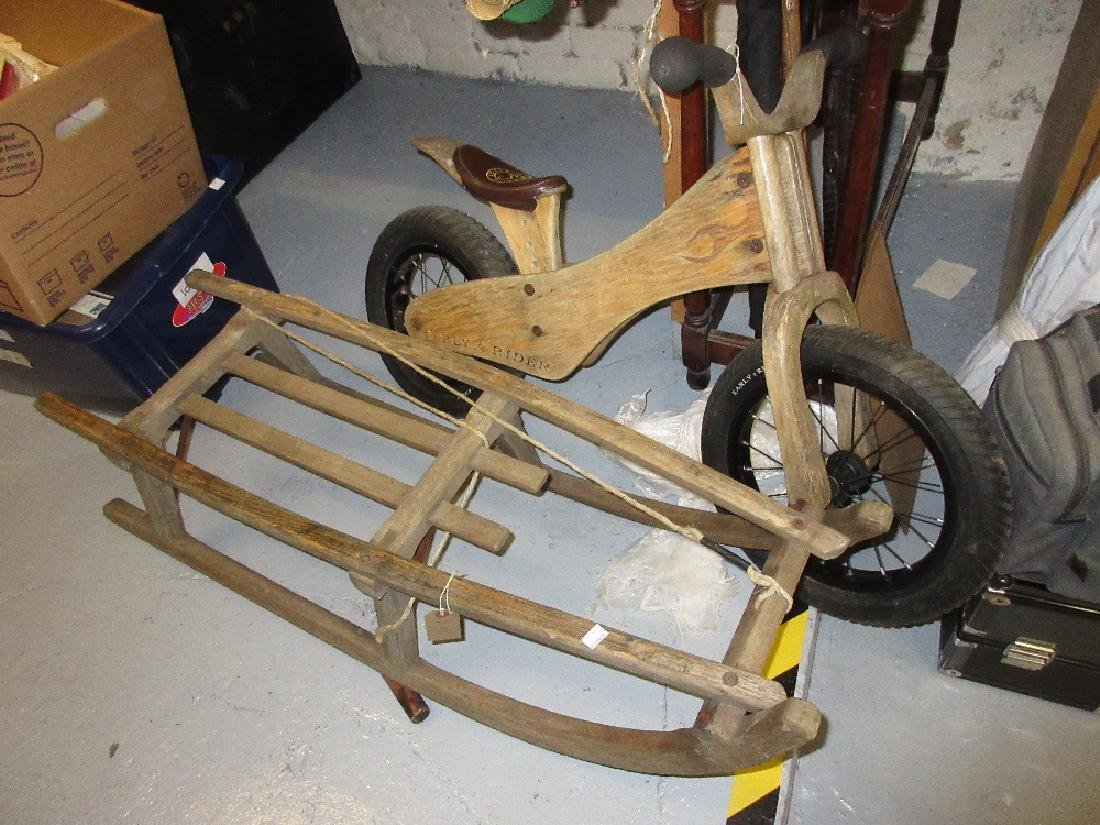 Childrens wooden sled together with a modern wooden