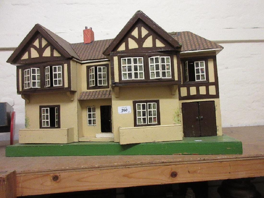 1930's Double fronted dolls house fitted with various