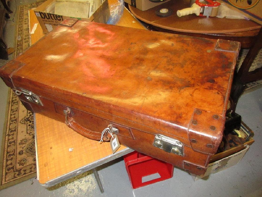 Good quality brown leather suitcase