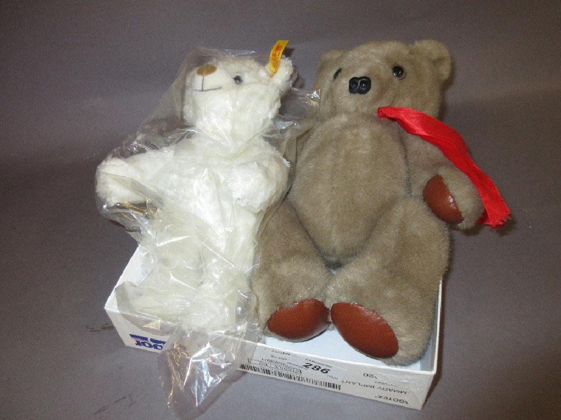 Modern Steiff white plush teddy bear together with