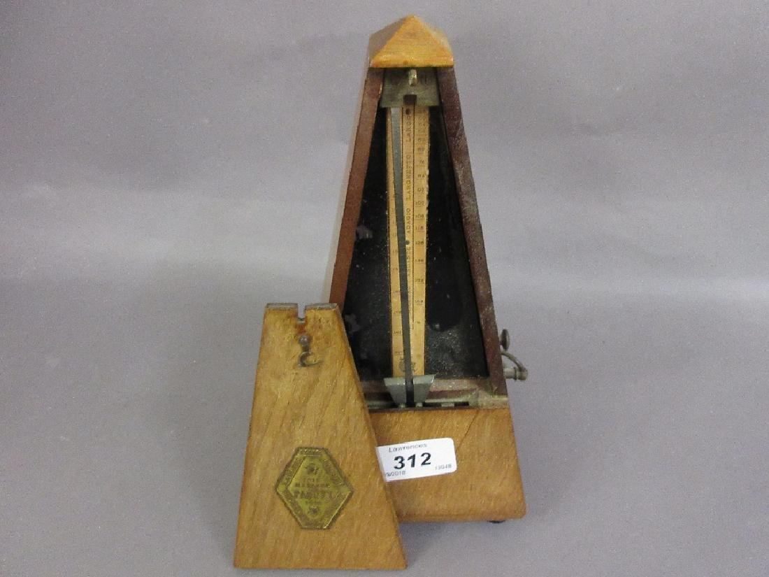 French walnut cased metronome by Paquet