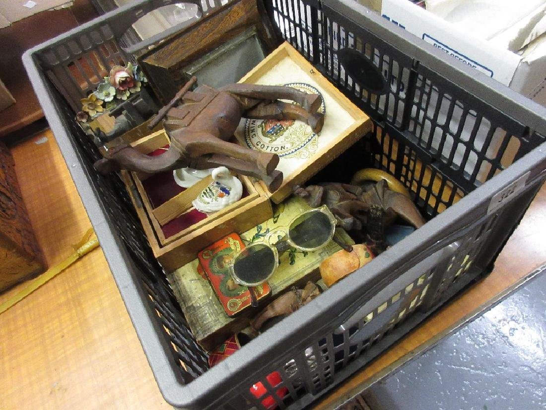 Box containing a collection of miscellaneous items to