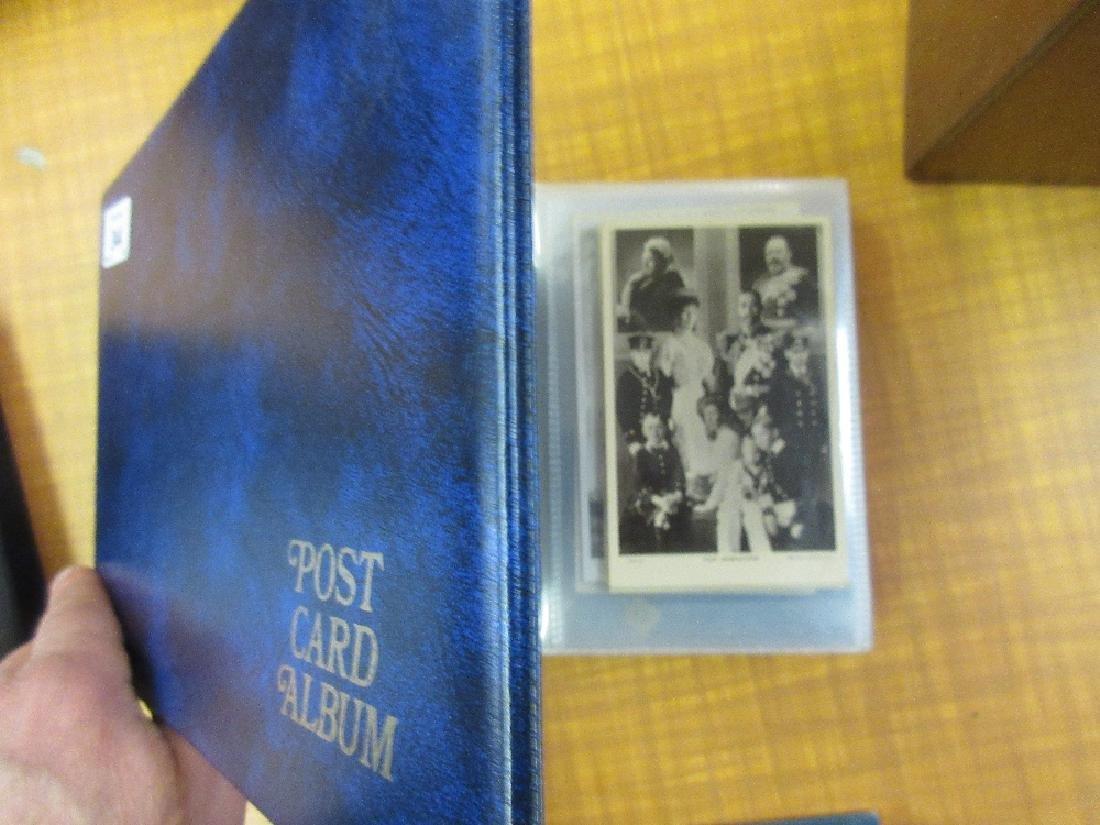 Blue album containing a quantity of Royalty postcards