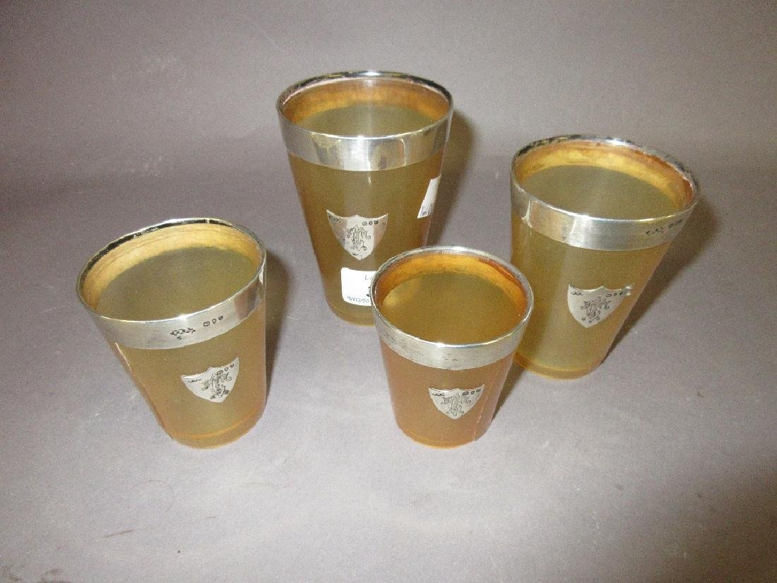 Set of four horn and silver mounted stirrup cups (at