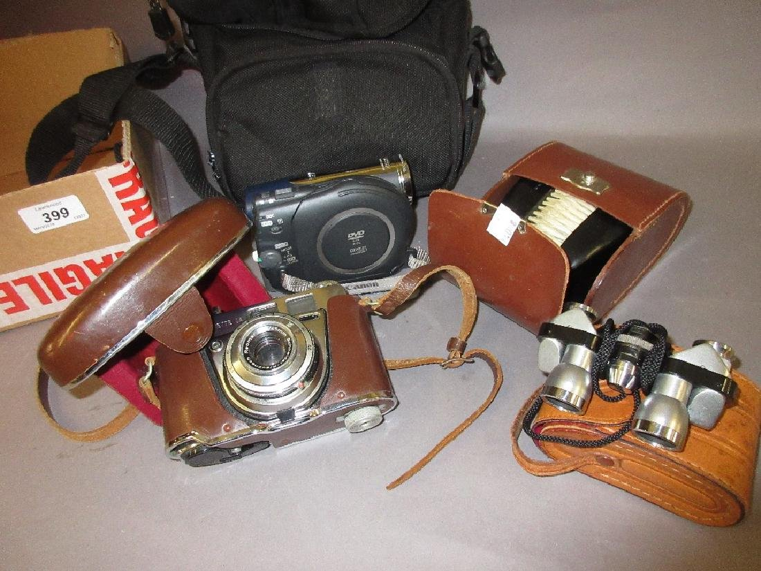 Early Kodak camera in leather case, pair of miniature