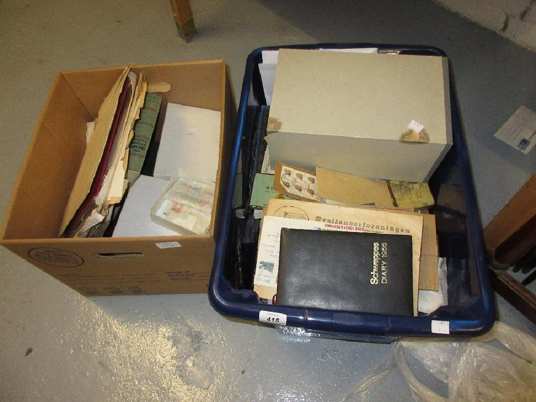 Two boxes containing a collection of various stamps in