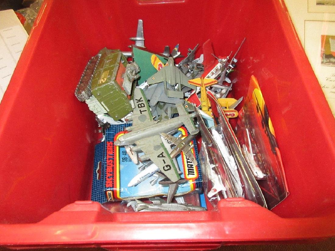 Box containing a collection of die-cast model aircraft