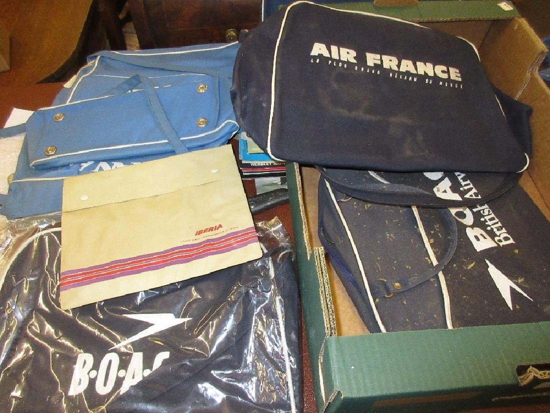 Collection of seven various bags decorated with airline