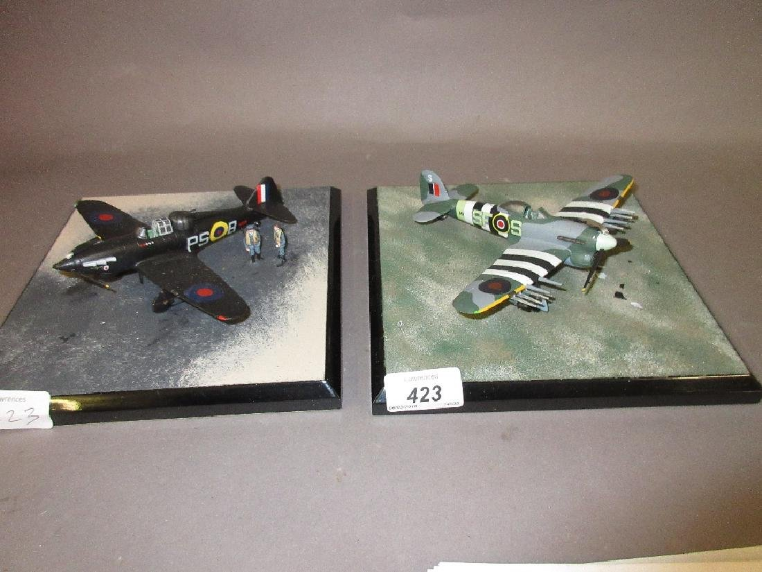 Two models of World War II fighter aircraft