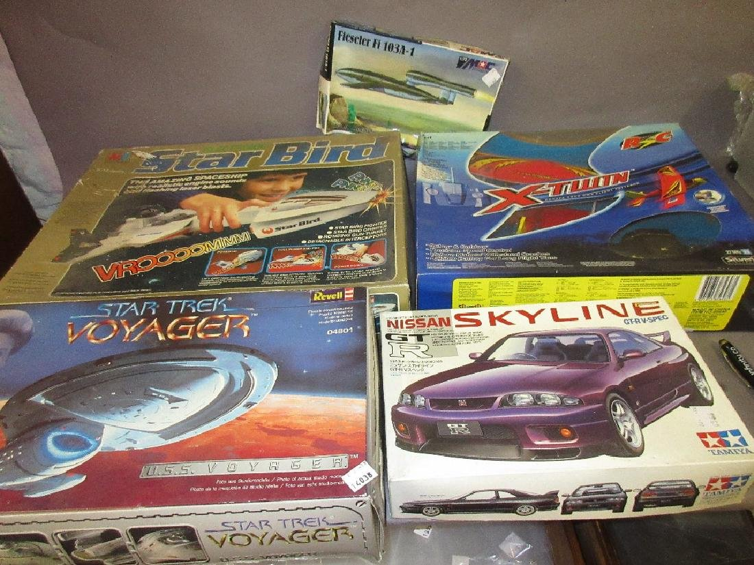 Five various plastic models and toys in original boxes
