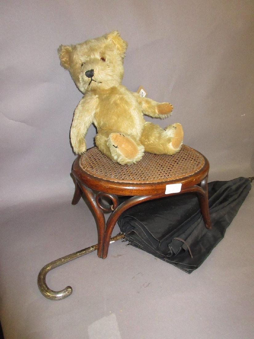 Gold plush jointed teddy bear, a small bentwood stool