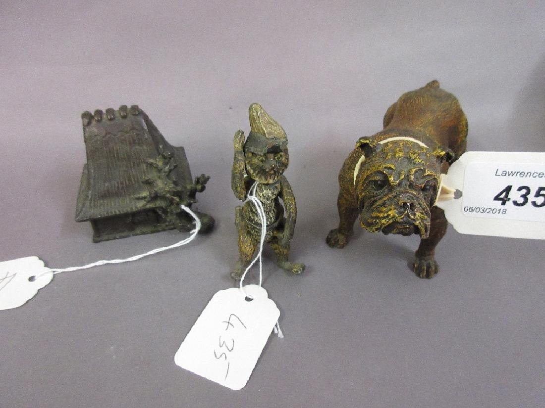 Metal figure of a bulldog, another of a cat with