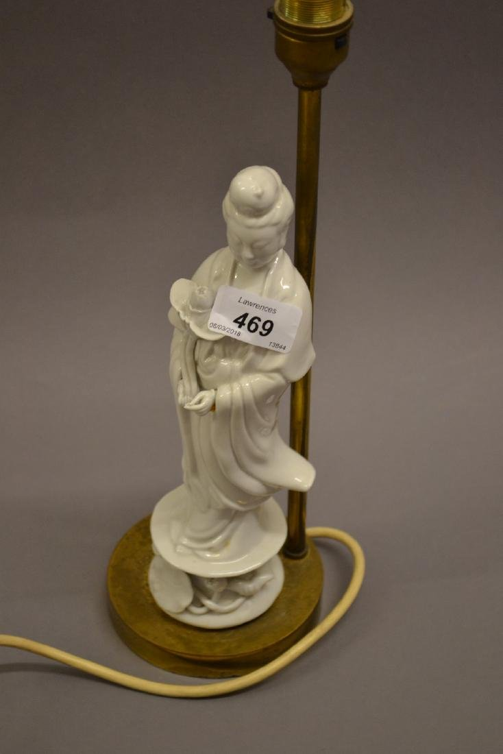 Blanc de chine figural lamp base on gilt metal stand