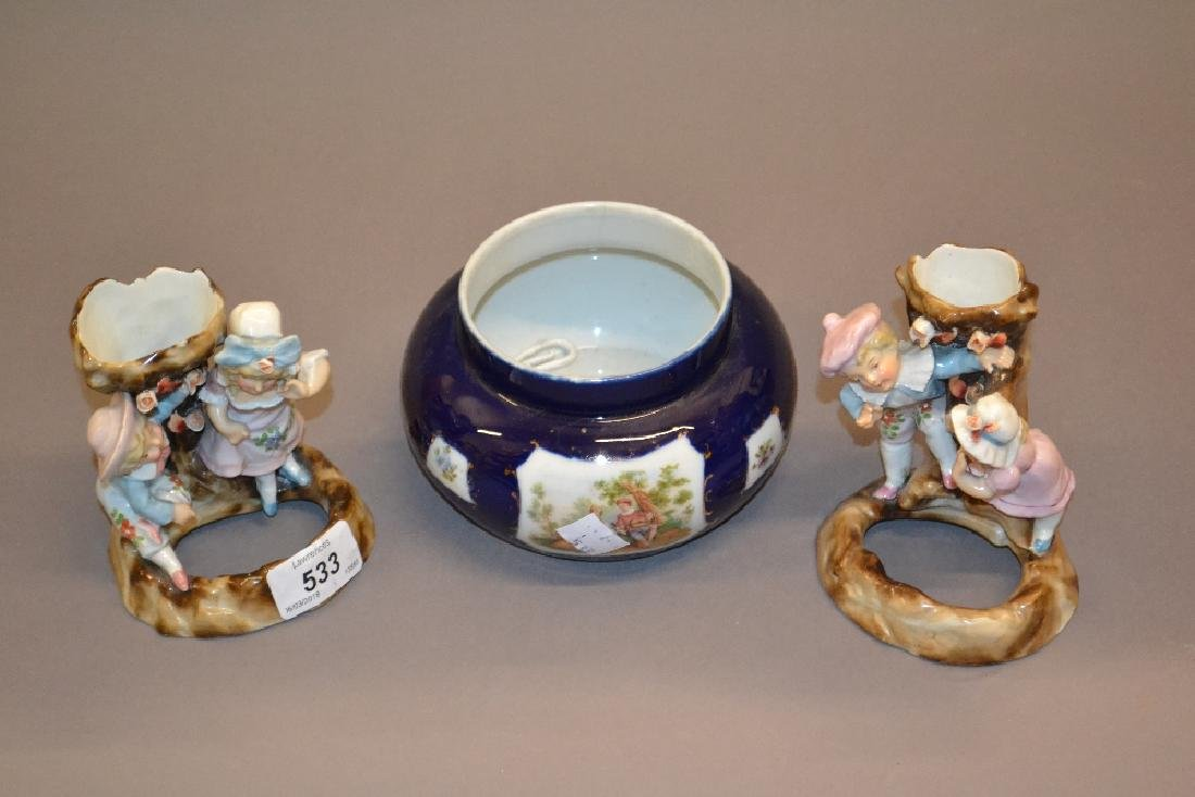 Pair of Continental porcelain spill holder groups in