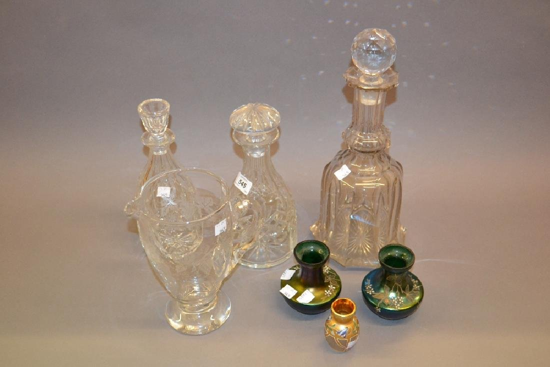 Three cut glass decanters with stoppers and a cut glass