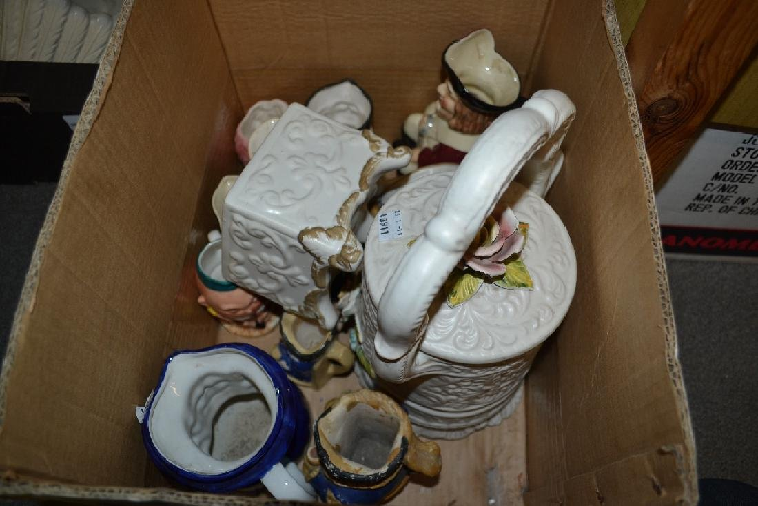 Box containing a quantity of various Toby jugs,