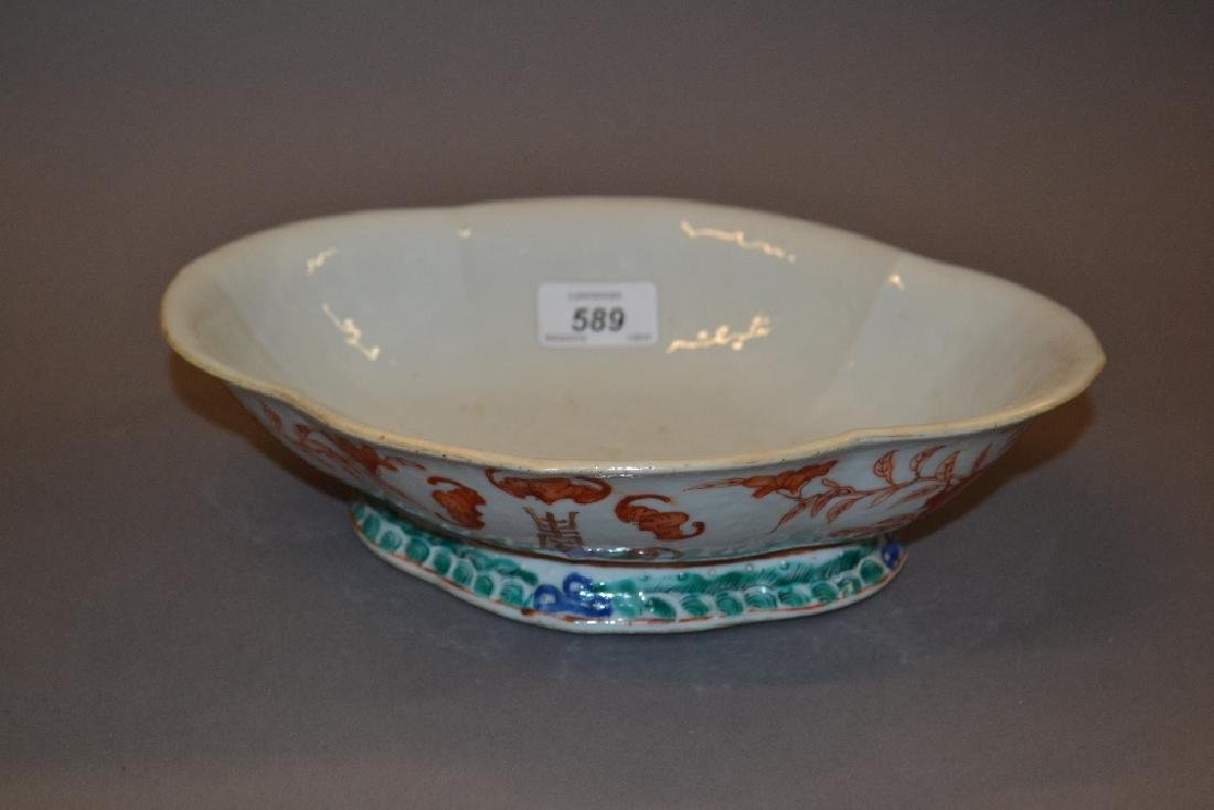 Chinese oval porcelain bowl decorated in cerise, signed