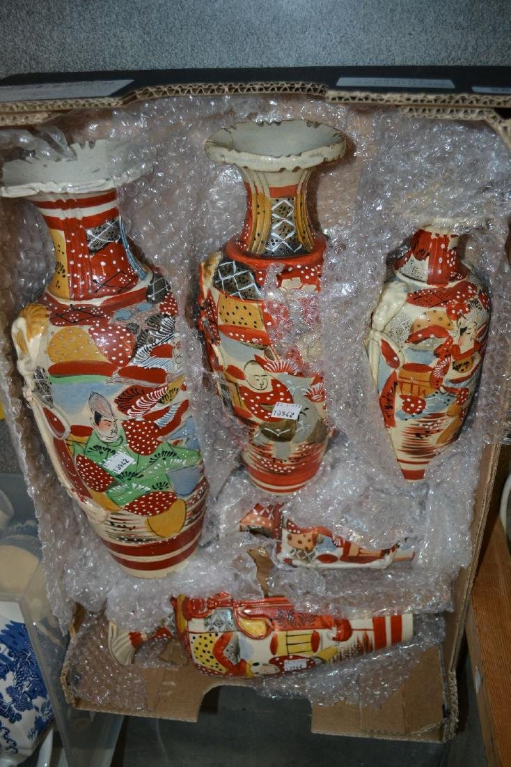 Group of five Japanese pottery baluster form vases
