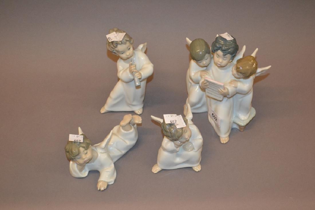 Group of four Lladro porcelain cherub figures