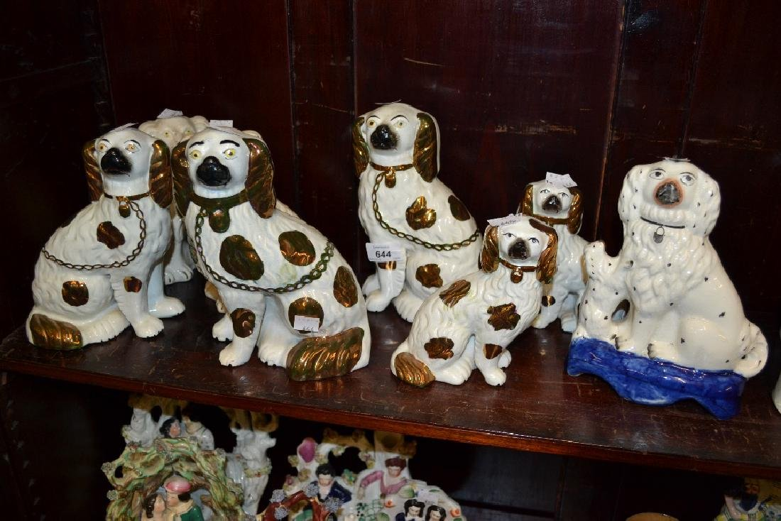 Three pairs of Staffordshire pottery spaniel figures