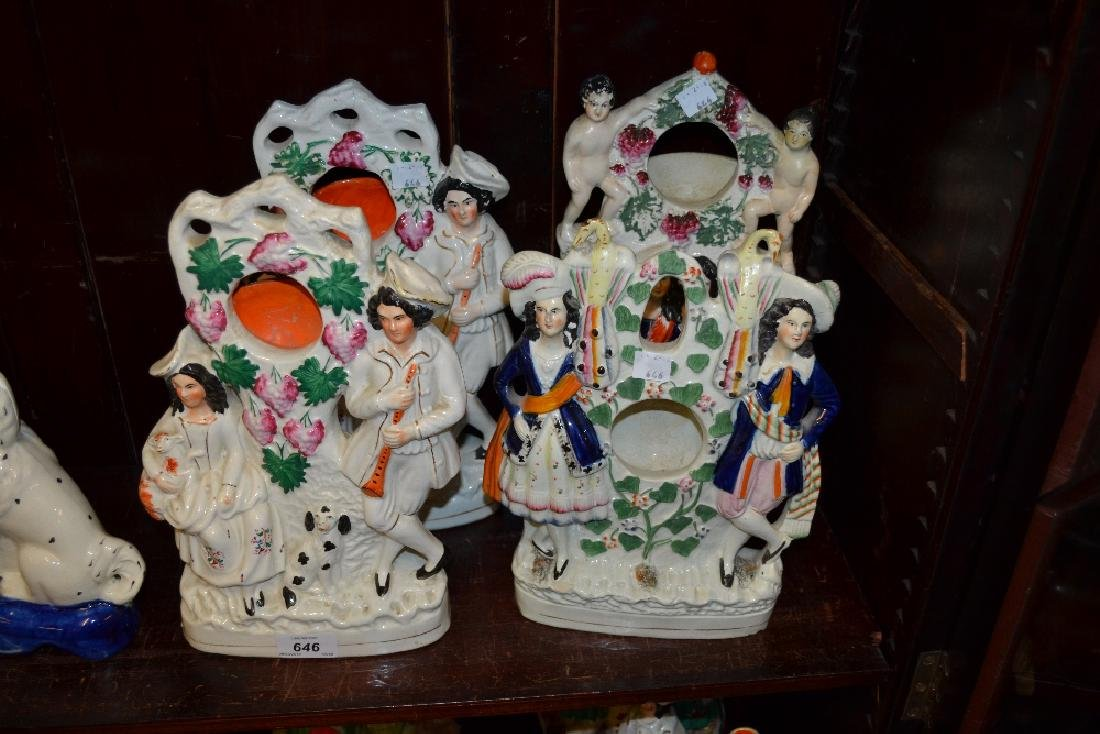 Four various Staffordshire pottery watch holder groups