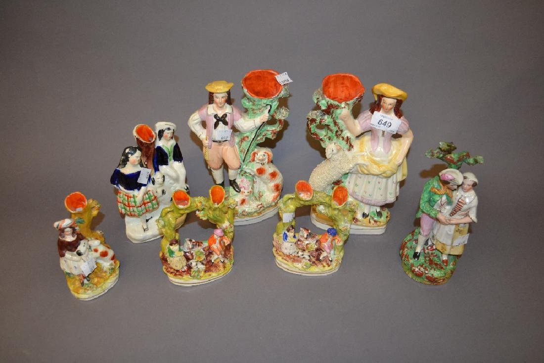 Seven various Staffordshire pottery spill vase groups