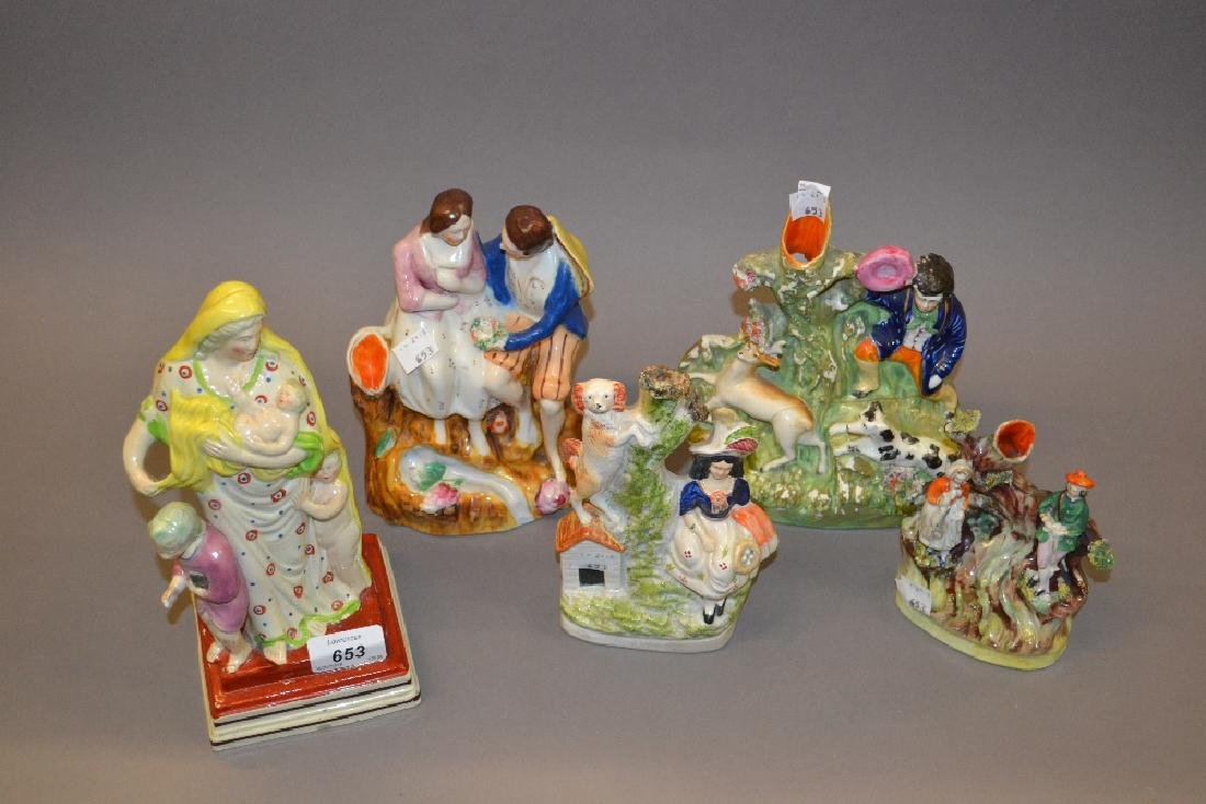 Five various Staffordshire pottery groups and figures