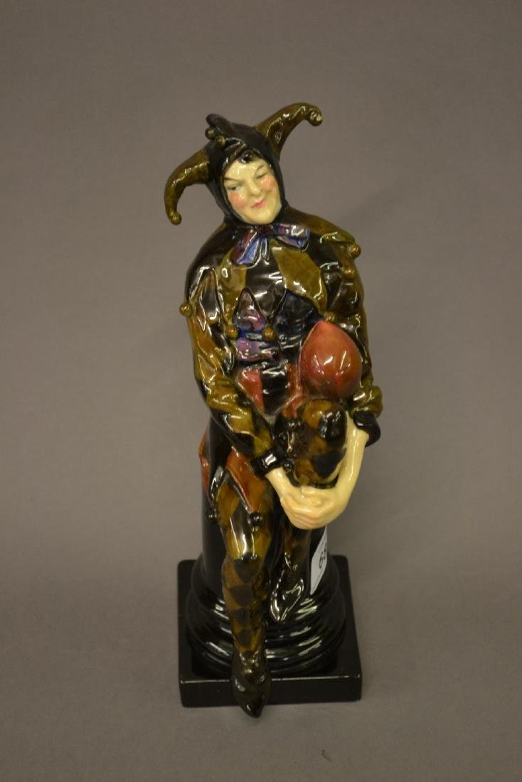 Royal Doulton figure, a Jester by Charles Noke, in