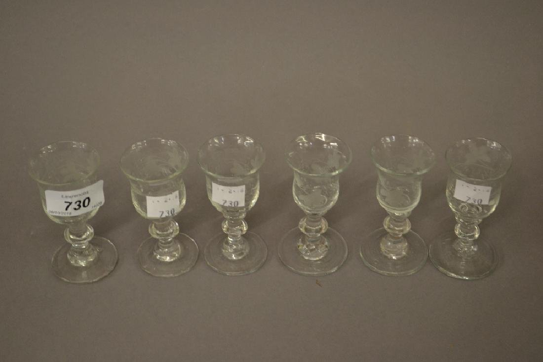Set of six small etched knopped stem glasses in