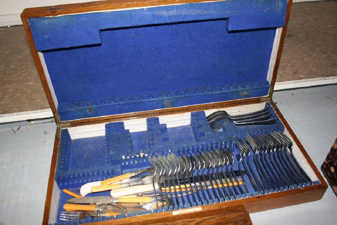 Large oak cased part canteen of silver plated cutlery,