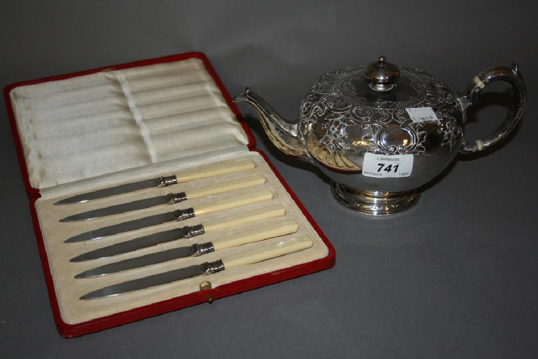 Victorian silver embossed teapot together with a set of