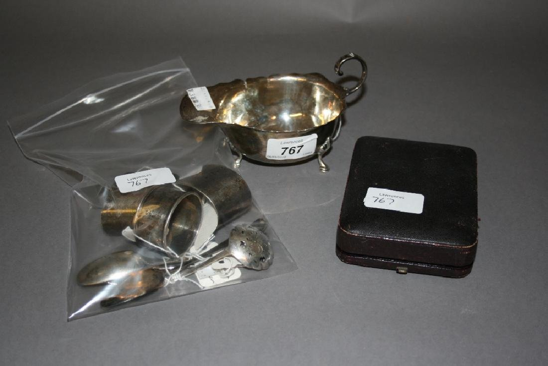 Silver sauce boat, pair of silver napkin rings, another