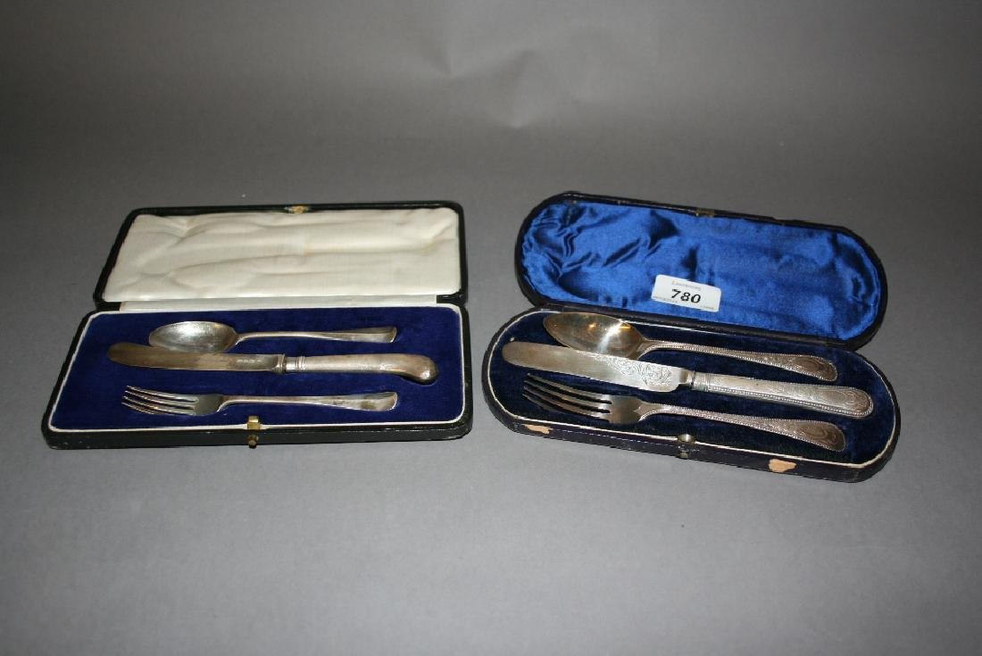Two cased silver three piece Christening sets