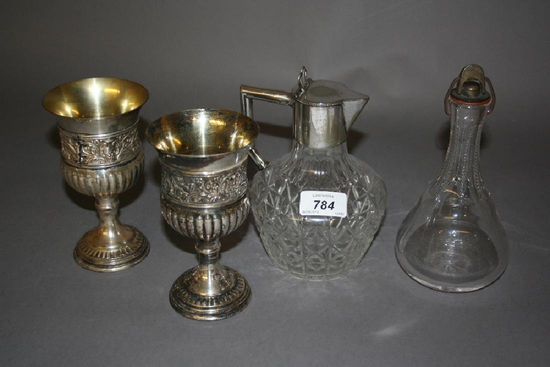Early 20th Century cut glass claret jug with plated