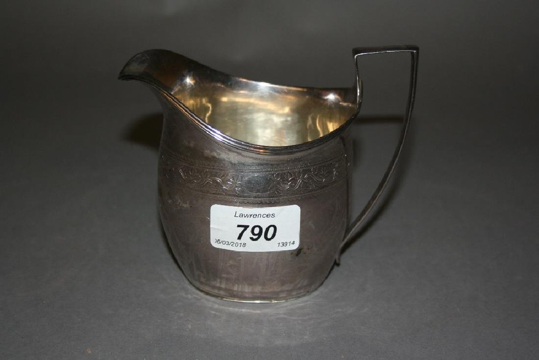 George III London silver creamer jug decorated with an