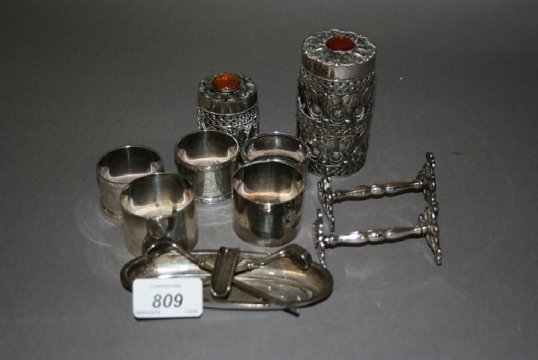 Two pairs of silver napkin rings together with another