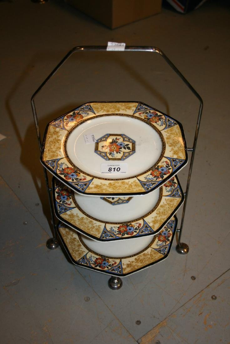 Early 20th Century plated cakestand with three Wedgwood