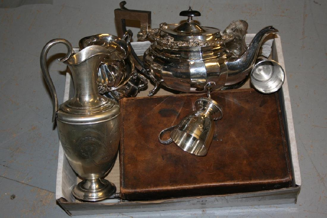 Cased set of four silver backed brushes together with a